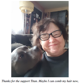 Titan, a gray pit bull, licks my cheek while I grimace. My hair is a mess.