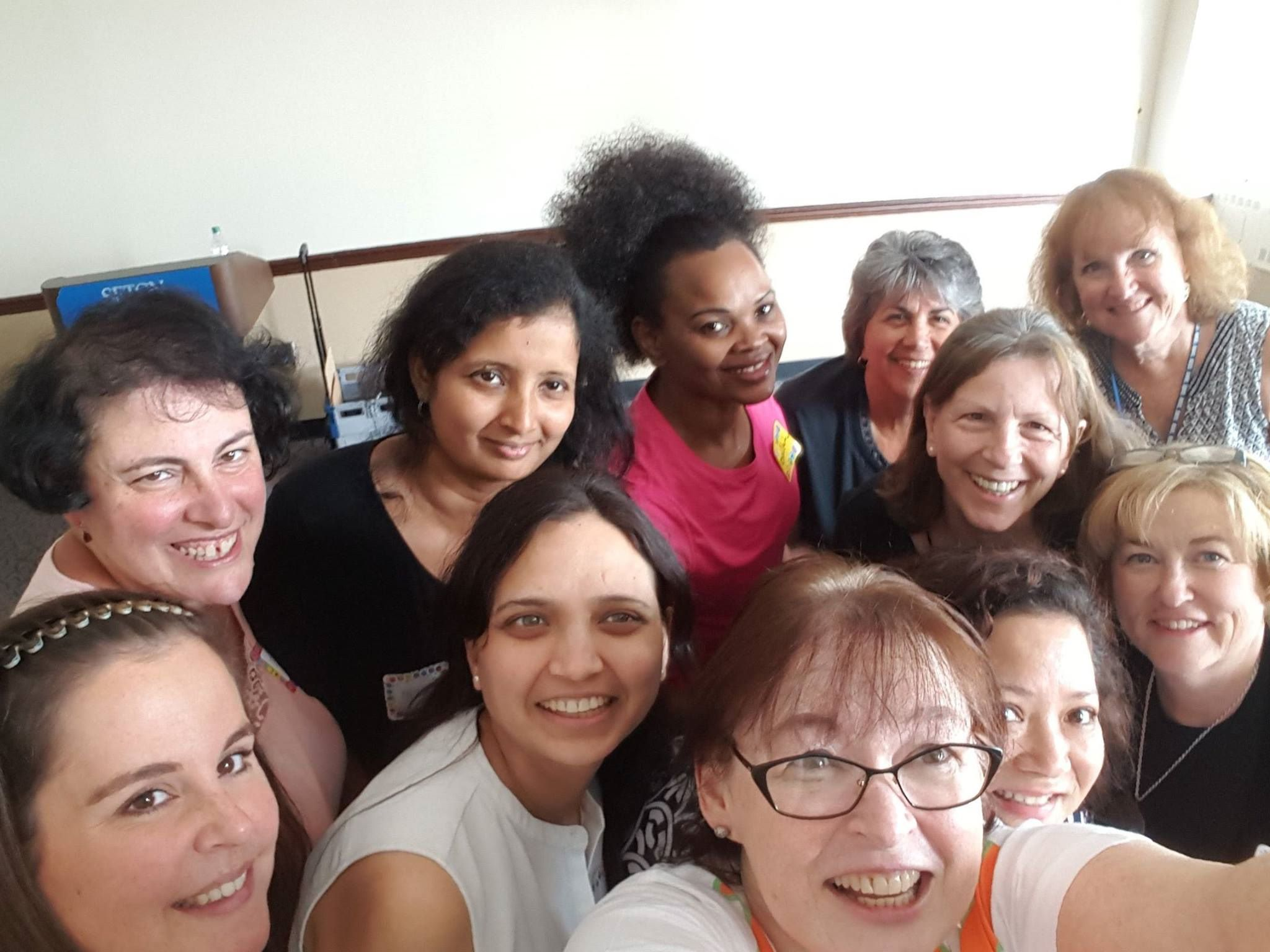 A diverse group of women from Seton Hall pose for a Laughter Selfie.